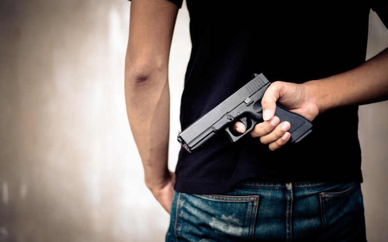 what happens if a convicted felon is caught with gun